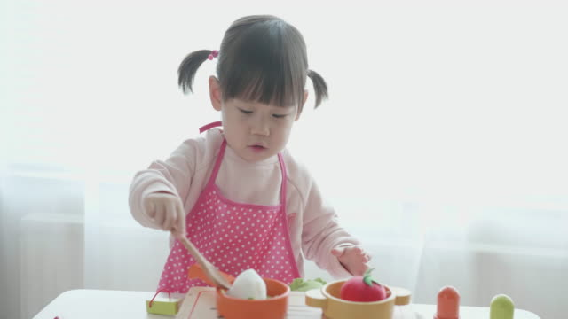 baby girl pretend play food toy at home - group of objects stock videos & royalty-free footage
