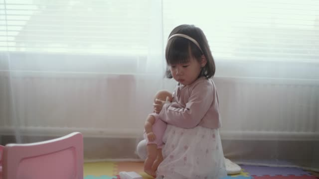 baby girl pretend playing at home - group of objects stock videos & royalty-free footage