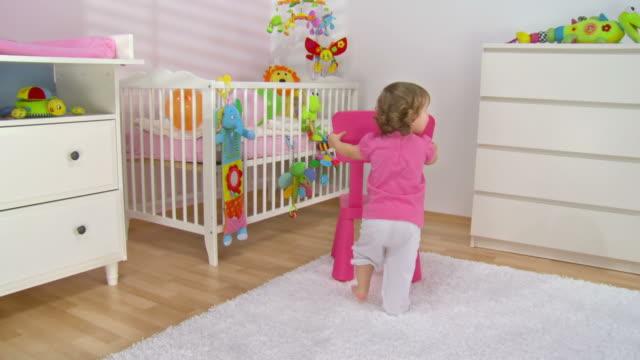 HD CRANE: Baby Girl Pushing Her Stool
