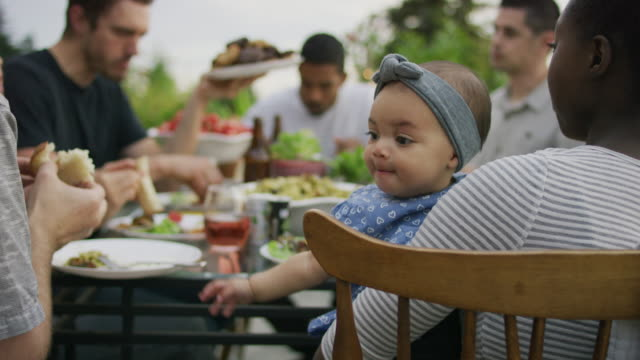 baby girl reaching for food - social gathering stock videos & royalty-free footage