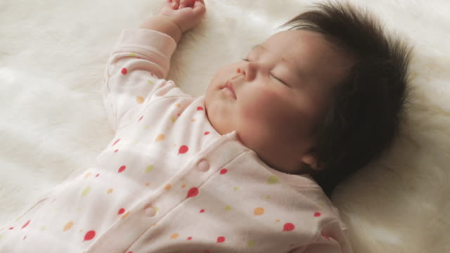 baby girl sleeping at home. - baby girls stock videos & royalty-free footage