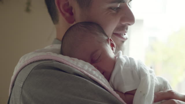 baby girl sleeping on her father's shoulder - newborn stock videos & royalty-free footage