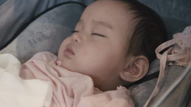 baby girl sleeping on her stroller - pushchair stock videos & royalty-free footage