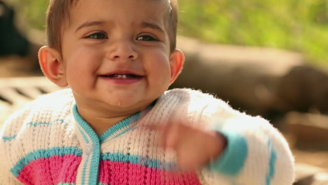 baby girl smiling, ballabhgarh, haryana, india - babies only stock videos & royalty-free footage