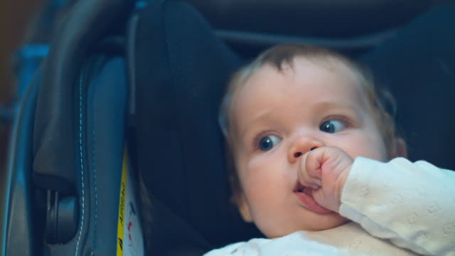 baby girl sucking fingers - pushchair stock videos and b-roll footage