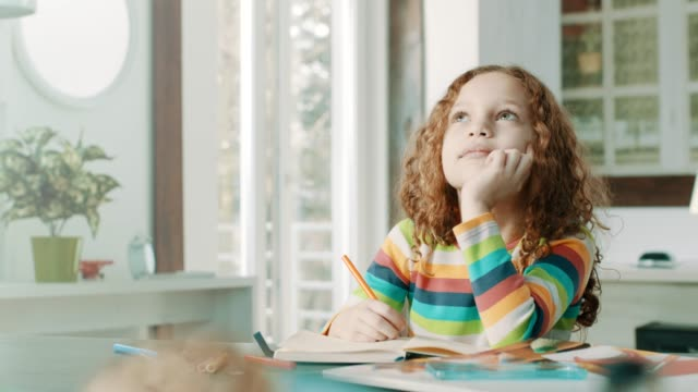 baby girl thinking about homework! - scrivere video stock e b–roll