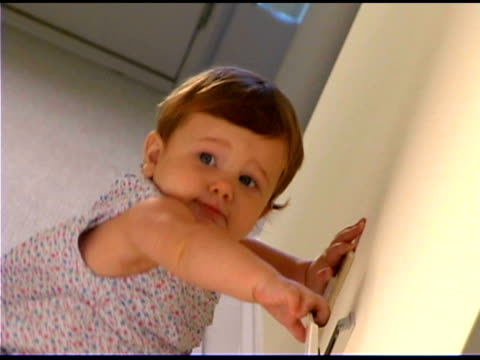 baby girl touching electrical outlet - only baby girls stock videos & royalty-free footage