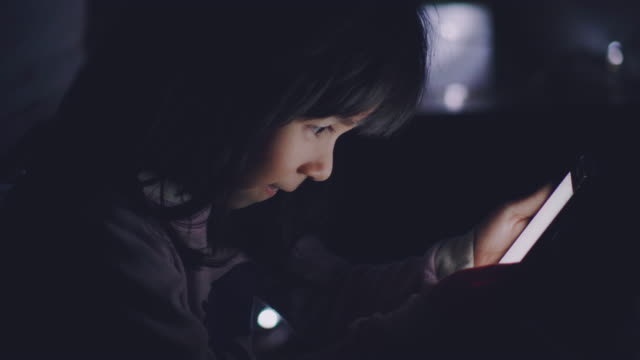 baby girl using smart phone at new year's eve - social issues stock videos & royalty-free footage
