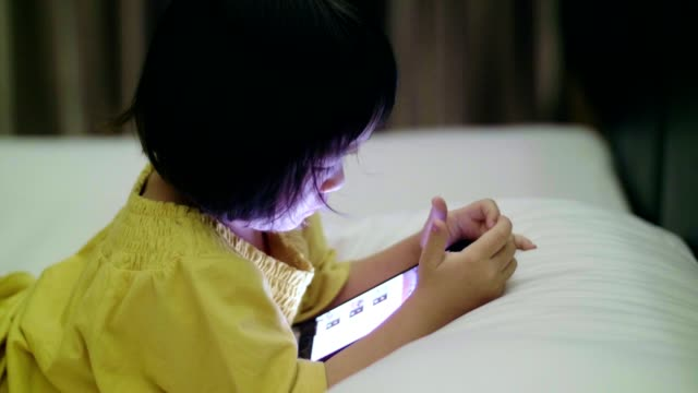 cu : baby girl(4-5 years) using smartphone at night - 4 5 years stock videos and b-roll footage