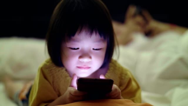 cu : baby girl(4-5 years) using smartphone at night - 4 5 years stock videos & royalty-free footage