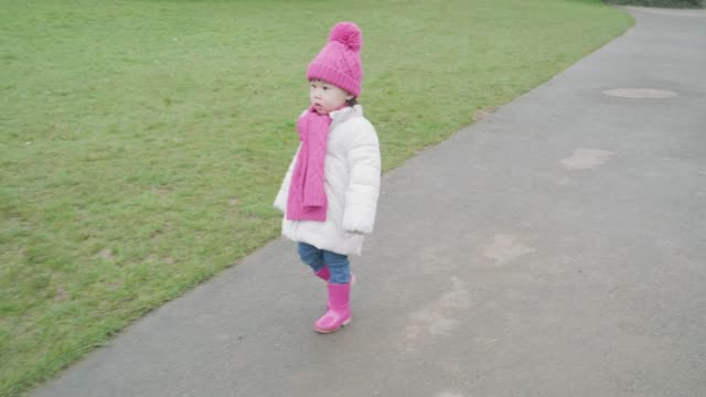 baby girl walk in the early spring  park - scarf stock videos & royalty-free footage