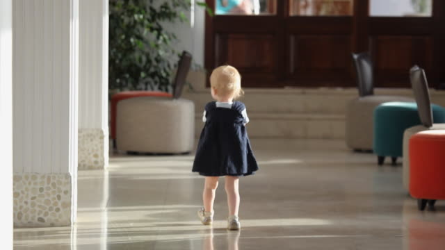 ws baby girl (12-23 months) walking in hotel lobby / palma de mallorca, mallorca, baleares, spain - 12 23 months stock videos & royalty-free footage
