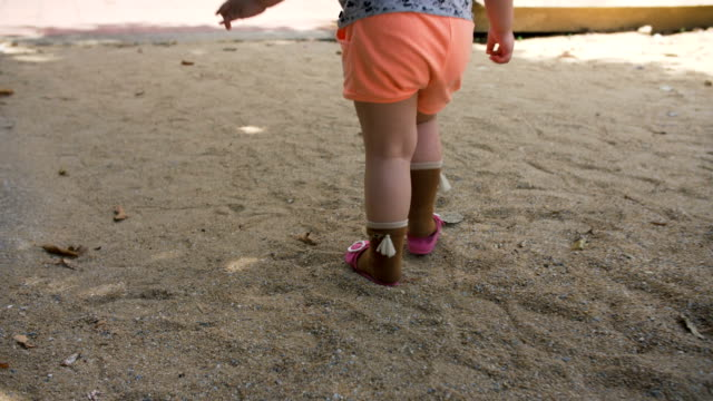 Baby girl walking on outdoor