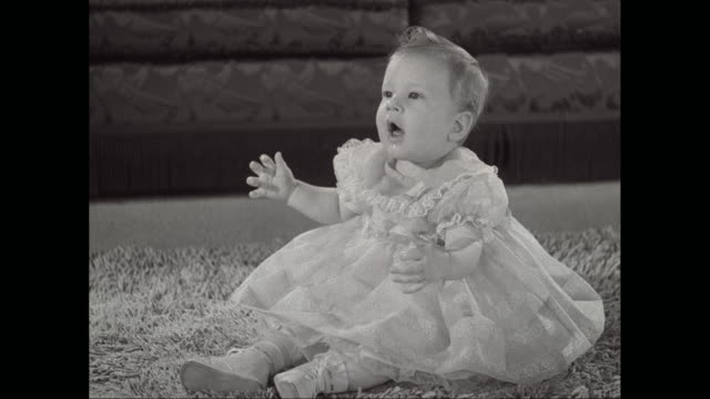 ms baby girl wears dress and playing on rug / united states - one baby girl only stock videos & royalty-free footage