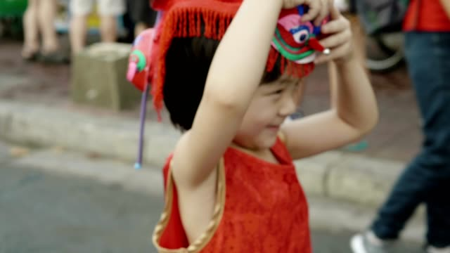 baby girl with toy enjoy chinese new year celebration - chinese new year stock videos & royalty-free footage