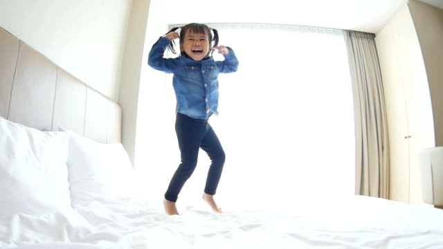 Baby Girls Jumping On The Bed