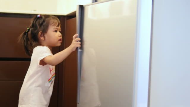 4k : baby girls open refrigerator - refrigerator stock videos and b-roll footage