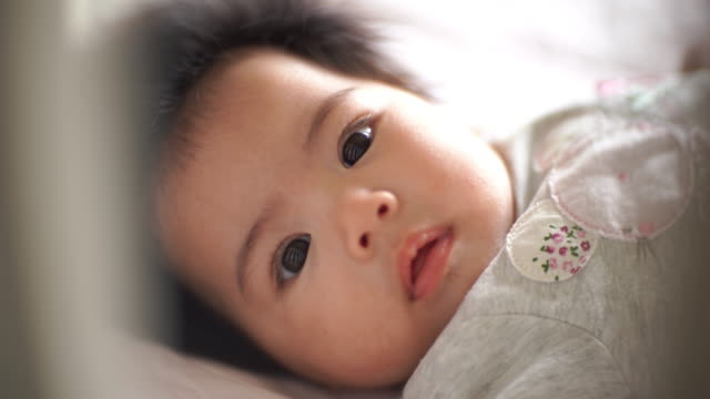 baby girls smiling, lying down in bed - month stock videos & royalty-free footage