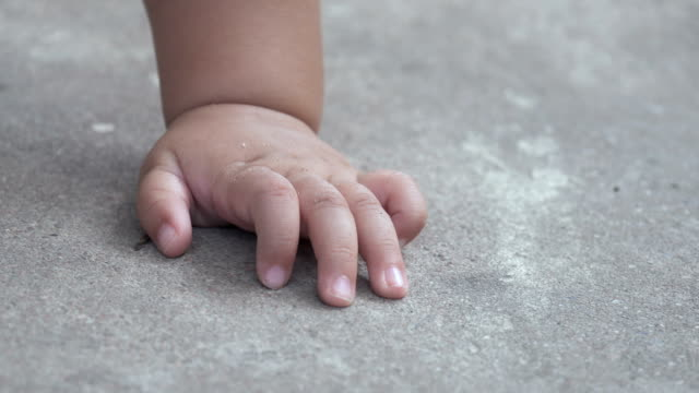 baby hand on concrete floor - human finger stock videos & royalty-free footage