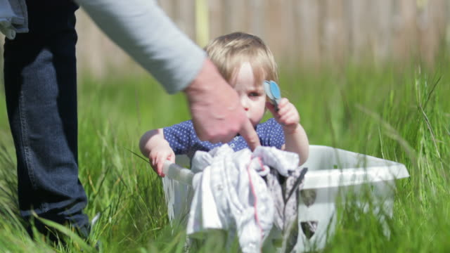 baby in a laundry basket - role reversal stock videos & royalty-free footage