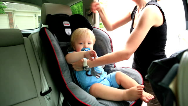 baby in car seat - vehicle seat stock videos & royalty-free footage