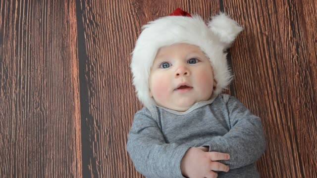 baby in christmas. - blue eyes stock videos & royalty-free footage