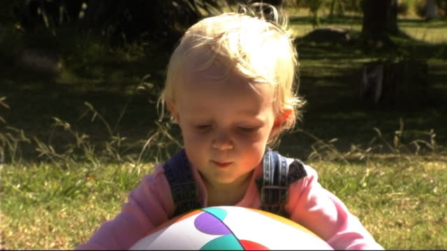 baby in park with ball - only baby girls stock videos & royalty-free footage