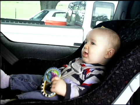 Baby in safety seat in car