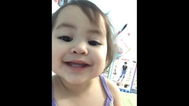 baby keira secretly records a video in her older sister's phone of the most precious rendition of the abc song you'll ever hear!how adorable and... - she's funny that way点の映像素材/bロール