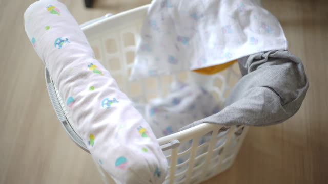 baby laundry piled in a basket - hamper stock videos & royalty-free footage