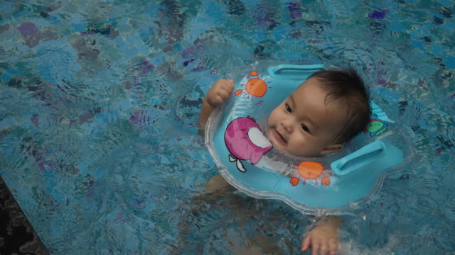baby learn to swim in the pool by wearing - arm band stock videos & royalty-free footage