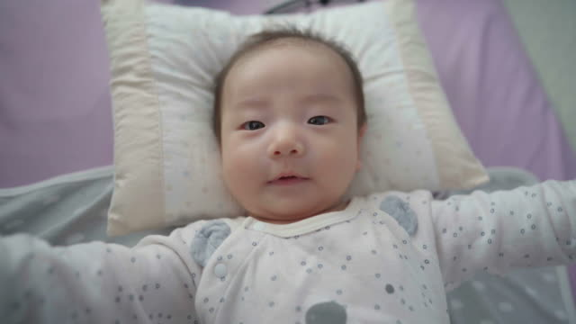 baby lying down on floor / yeongju-si, gyeongsangbuk-do, south korea - blanket stock videos & royalty-free footage