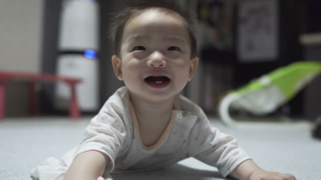 baby lying down on floor / yeongju-si, gyeongsangbuk-do, south korea - lying on front stock videos & royalty-free footage