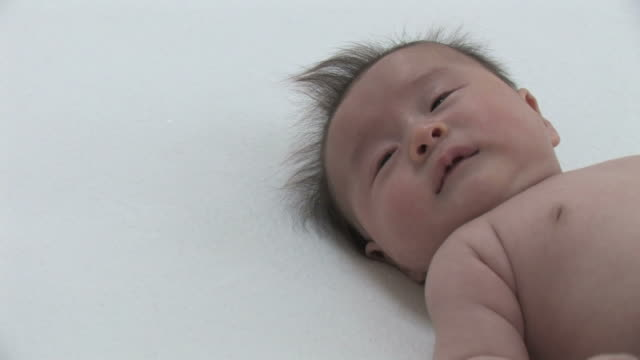 ha cu baby lying on back, crying - lying on back stock videos & royalty-free footage