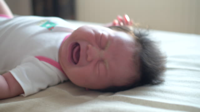 baby lying on bed and crying - crying stock videos & royalty-free footage
