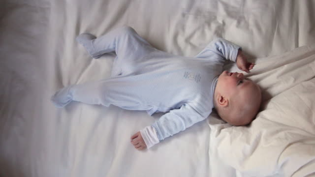 CU Baby lying on bed / Los Angeles, California, USA