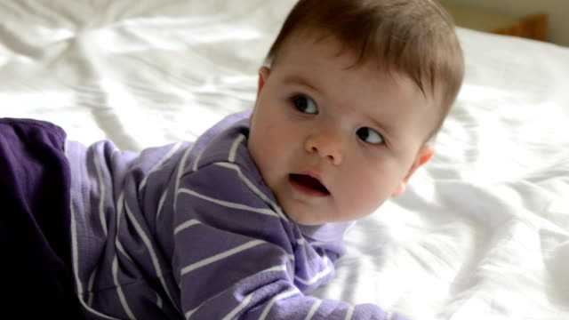 baby lying on bed, smiling - one baby girl only stock videos & royalty-free footage