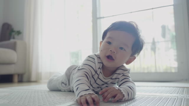 baby lying on his stomach trying to keep your head - baby girls stock videos & royalty-free footage