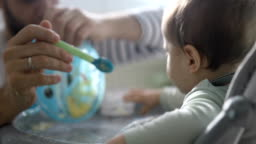 Baby making big mess while eating