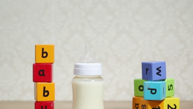 baby milk and alphabet blocks - capital letter stock videos & royalty-free footage