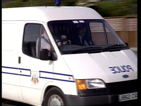 Nurse sentenced NAF ENGLAND Notts Rampton CMS SIGN 'Rampton Hospital' CMS Police van towards PAN LR as past to BV as cameraman in BV filming CBV...