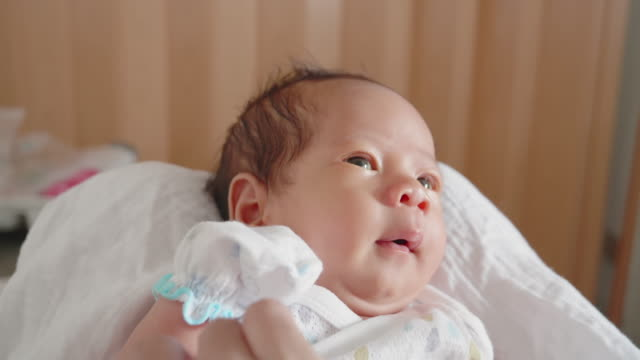 baby; newborn baby boy face close up of eurasian ethnicity. - eurasian ethnicity stock videos and b-roll footage