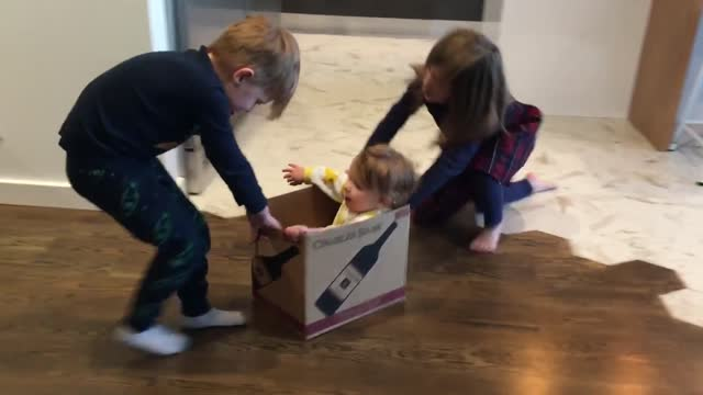 baby olive had lots of fun when her siblings pulled and pushed her around the room in a wine box. mom maria smith filmed the funny scene. who needs... - parent stock videos & royalty-free footage