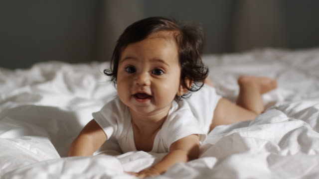 baby on a bed - polynesian ethnicity stock videos & royalty-free footage
