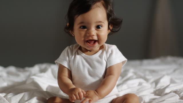 baby on a bed - bouncing stock videos & royalty-free footage