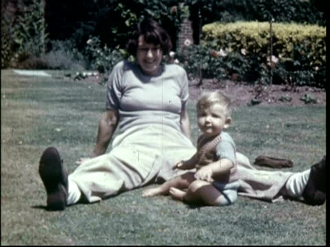 stockvideo's en b-roll-footage met baby on grass and in play pen, 1951 - kruipen