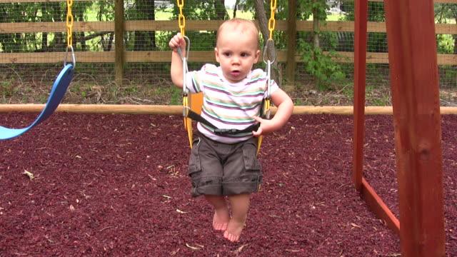 baby on swing - endast en pojkbaby bildbanksvideor och videomaterial från bakom kulisserna