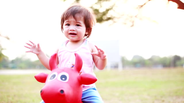 Baby play rocking horse at playground