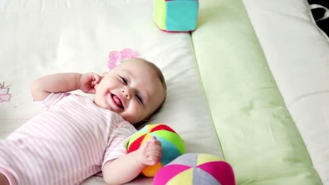 Baby playing and smiling