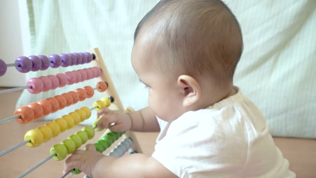 Baby playing colorful abacus toy